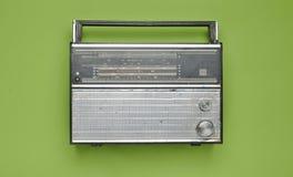 Obsolete retro radio receiver on a green pastel background. Top view Stock Photos