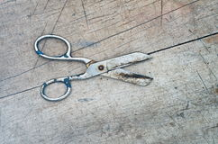 Obsolete scissors on a wooden background Royalty Free Stock Photos