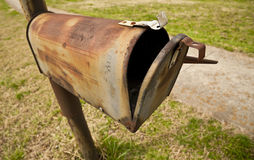 Obsolete Snail Mail Box. An old rusted out obsolete snail mail mail box Royalty Free Stock Photography