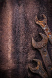 Obsolete spanner wrenches on vintage leather. Construction concept Royalty Free Stock Photo