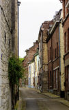 Obsolete Street in Dinant. Obsolete Narrow Street with Multi Colored Old Houses in Cloudy Day Outdoors. Dinant, Belgium Stock Images