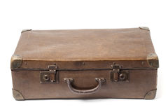 Obsolete Suitcase On White. Closed obsolete suitcase isolated on white background Royalty Free Stock Image