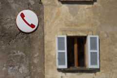 Obsolete telephone sign in Italy. Telephone sign on a wall in Europe stock image