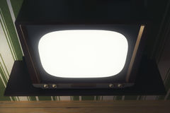 Obsolete TV with white screen Royalty Free Stock Photography