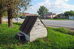 Obsolete village well  on the side of the highway Stock Photography