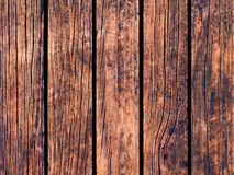 Obsolete wood texture with vertical lines. Warm brown wooden background for natural banner. Royalty Free Stock Photo