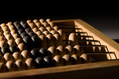Obsolete wooden abacus. Black background Royalty Free Stock Photo