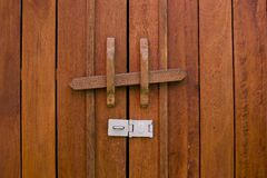 Obsolete wooden door bolt, Thai tradition Royalty Free Stock Photography