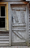 Obsolete wooden door of very old house Royalty Free Stock Images