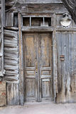 Obsolete wooden door of very old house in Astrakhan, Russia Stock Photos