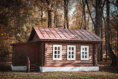 Obsolete wooden hut in village. Autumn day in the woods Royalty Free Stock Photos