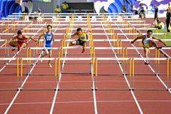 Obstáculos de 110 medidores dos homens Fotos de Stock Royalty Free