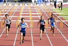 Obstáculos de 110 medidores dos homens Imagem de Stock Royalty Free