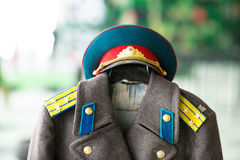 Obstacle course. Sample military coat and peaked cap Royalty Free Stock Image