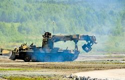 Obstacle remover IMR-2MA in action stock images