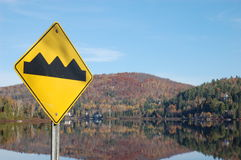 Obstacles Ahead. Bumps ahead road sign. Mountains in Background Stock Images