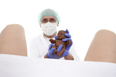 Obstetrician. Doctor obstetrician receives childbirth on white background Stock Image
