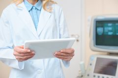 obstetrician gynecologist using tablet with ultrasonic scanner stock photography