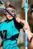 Obstrução do jogador do Lacrosse das mulheres Imagens de Stock Royalty Free