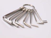 Obstrua chaves inglesas em uma luz - fundo cinzento Imagem de Stock