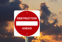 Obstruction sign with stormy clouds Stock Photos