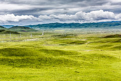 Obszar trawiasty i chmury obrazy royalty free