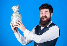Obtaining funding for his startup company. Happy businessman holding glass jar with money cash to cover startup costs. Bearded man investing money in startup stock photos