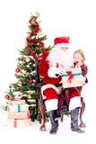 Obtendo o presente de Santa Claus imagem de stock royalty free