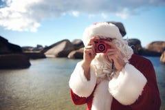 Obtendo sua imagem tomada por Santa Imagens de Stock Royalty Free