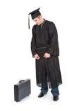 Obtention du diplôme : Le diplômé de mâle maintenant doit trouver un travail Photo libre de droits
