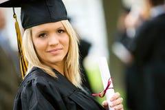 Obtention du diplôme : Licenciés sérieux préparent pour l'avenir Photos libres de droits