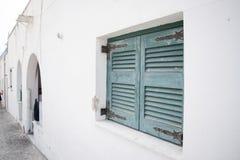 Obturadores da janela na parede branca Fotografia de Stock
