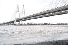 Obukhovsky bridge across Neva river. At cloudy winter day in Saint-Petersburg, Russia royalty free stock images