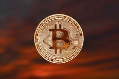 Obverse of crypto currency bitcoin on a red-brown beautiful background. Royalty Free Stock Photos