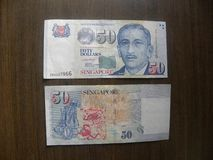 Front and back of 50 dollars Singapore banknote stock images