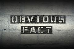 Obvious fact gr. Obvious fact stencil print on the grunge white brick wall Royalty Free Stock Image