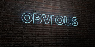 OBVIOUS -Realistic Neon Sign on Brick Wall background - 3D rendered royalty free stock image. Can be used for online banner ads and direct mailers stock illustration