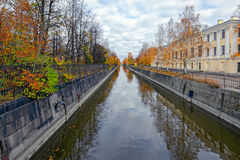 Obvodny (Bypass) channel in Kronstadt at Kotlin island, Russia. Ancient building of Kronstadt Admiralty on the banks of the Obvodny (Bypass) channel. Kronstadt Royalty Free Stock Image