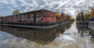 Obvodny (Bypass) channel in Kronstadt at Kotlin island, Russia. Ancient building of purveyance warehouse of Kronstadt Admiralty built in the years 1794-1795 Stock Photography