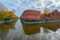 Obvodny (Bypass) channel in Kronstadt at Kotlin island, Russia. Ancient building of purveyance warehouse of Kronstadt Admiralty built in the years 1794-1795 Royalty Free Stock Photo