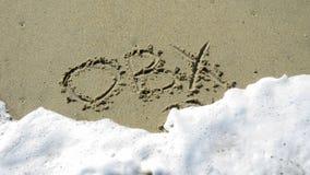 OBX écrit dans le sable Photos libres de droits