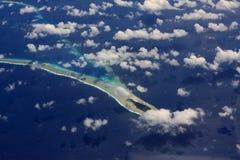 Océan et île corallienne Image libre de droits