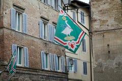 Oca flag at the contrada border, Siena, Tuscany, Italy Stock Photo