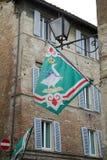 Oca flag at the contrada border, Siena, Tuscany, Italy Stock Images