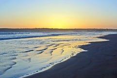 Ocaso en la playa Fotos de archivo