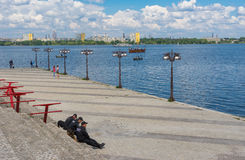 Occasional people on the river Dnepr embankment. DNEPROPETROVSK, UKRAINE - May 09, 2016:Occasional people on the river Dnepr embankment during Victory Day royalty free stock image