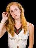 Occhi azzurri attraenti dei capelli biondi della fragola femminili Immagine Stock
