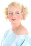 Occhi azzurri biondi della ragazza Fotografie Stock