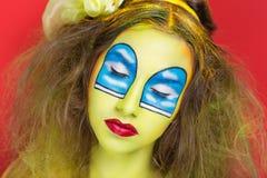 Occhi blu delle finestre di arte del fronte Fotografia Stock
