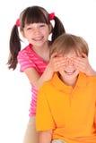 Occhi del fratello della copertura della sorella Fotografia Stock